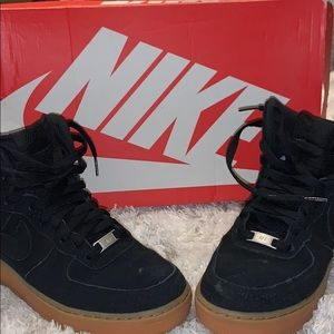 Black suede Nike shoes
